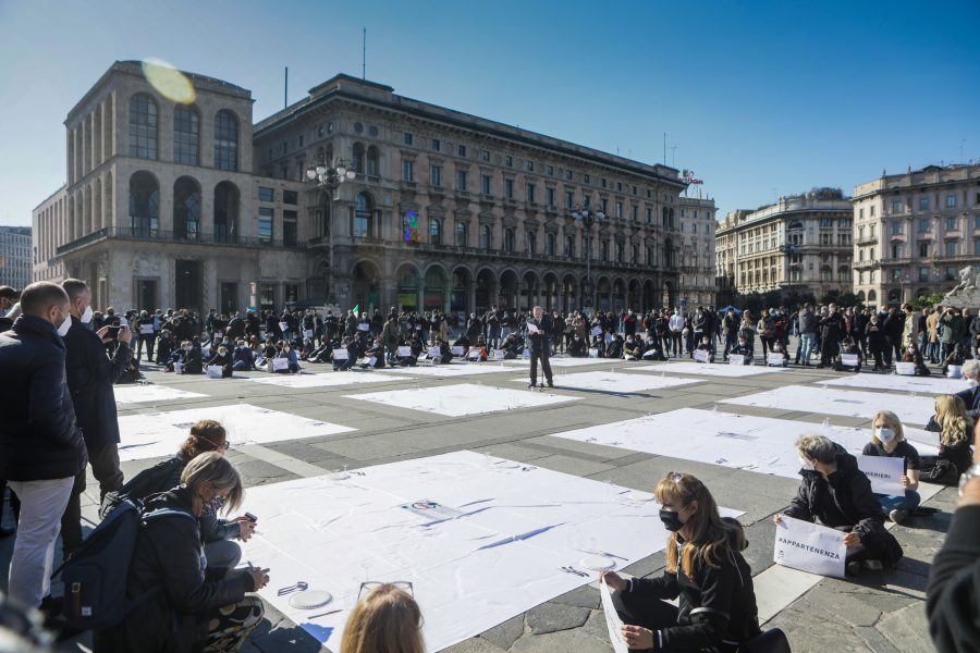 Protest of the Italian restaurateurs against the decree that imposes the closure of the activities at 18 to reduce the contagion from coronavirus, Milan, Italy, October 28 2020. To protest, the restaurateurs have set up an empty table in Piazza Duomo in Milan, as a sign of mourning for the lack of openings.